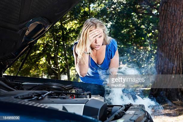 Beautiful blonde stranded by broken down car is helpless
