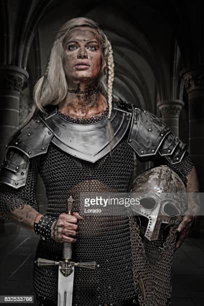 beautiful blonde sword wielding viking warrior female - viking stock photos and pictures