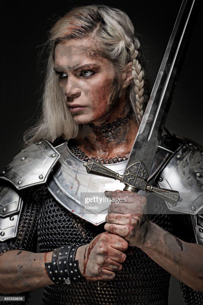 Sword Wielding Viking Warrior Brunette Female In Studio