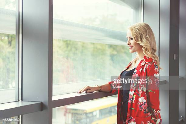 beautiful blonde woman in floral pattern outfit - izusek stock pictures, royalty-free photos & images