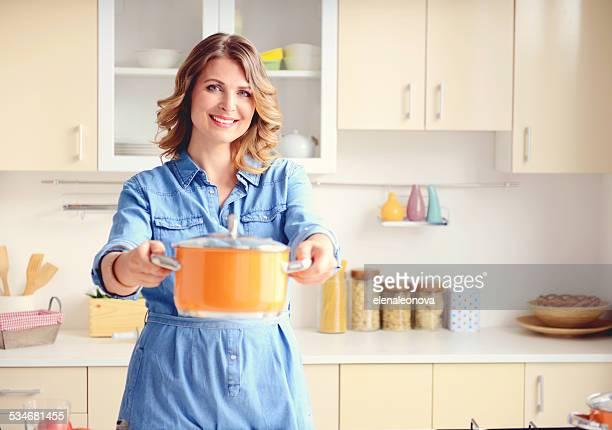 beautiful blonde woman in the modern kitchen