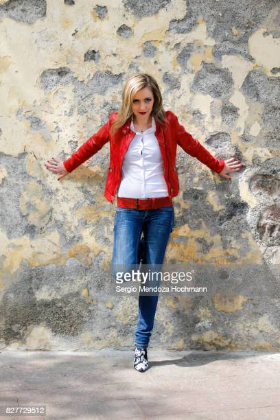 a beautiful blonde woman looking stylish in front of a grungy wall - mexico city, mexico - one mid adult woman only stock pictures, royalty-free photos & images