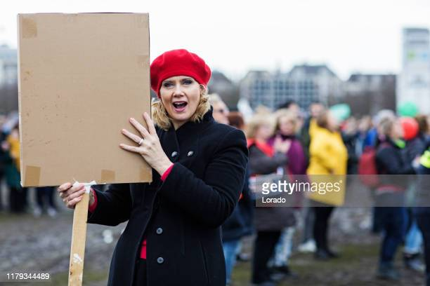 beautiful blonde woman protesting - activist stock pictures, royalty-free photos & images