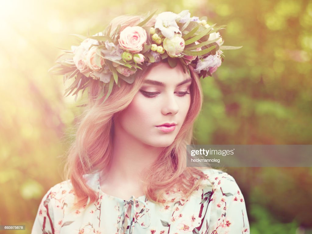 Beautiful blonde woman with flower wreath on her head stock photo beautiful blonde woman with flower wreath on her head stock photo izmirmasajfo
