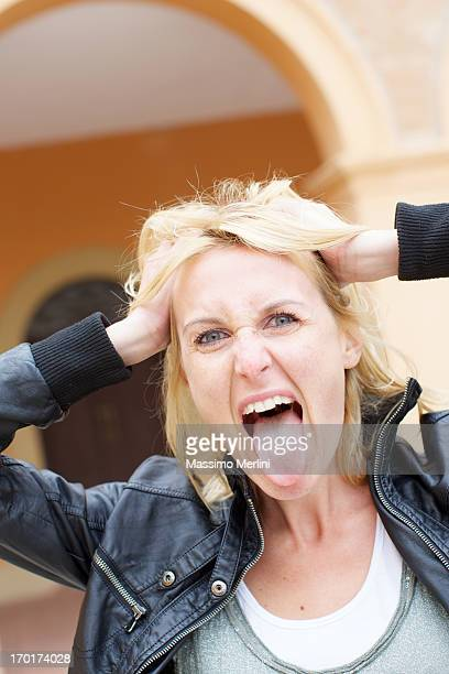 beautiful blonde woman with tongue out - woman long tongue stock photos and pictures