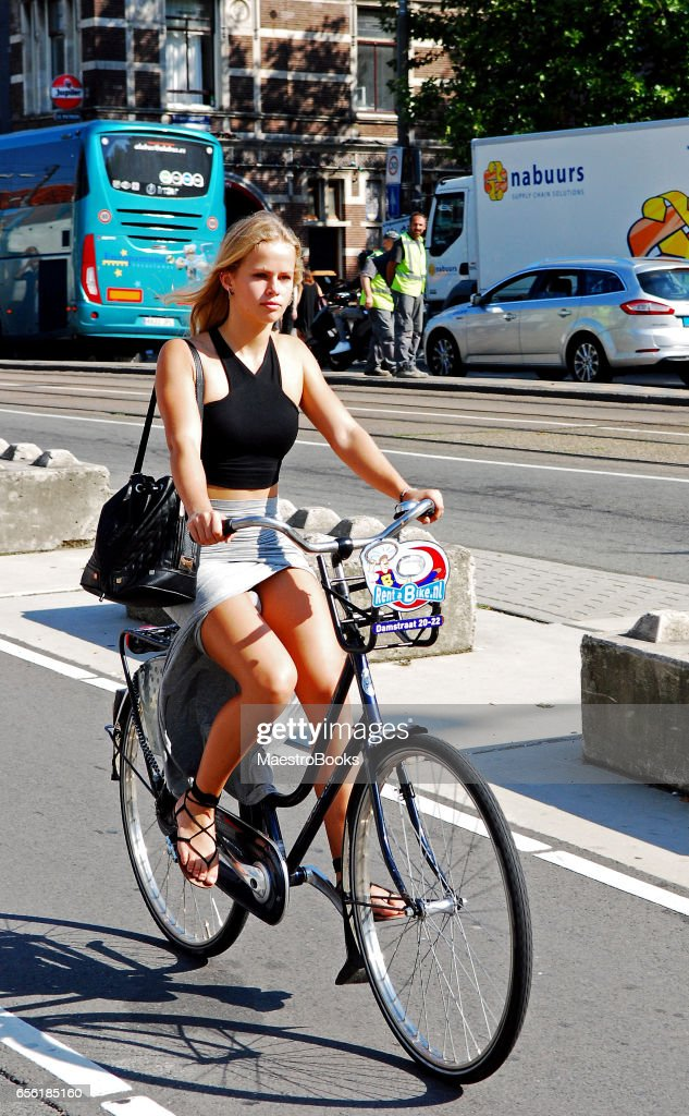 Beautiful Blonde young woman cycling in Amsterdam : Stock Photo