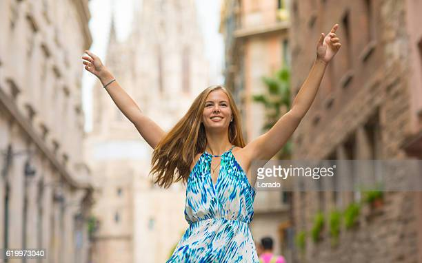 Beautiful blonde young woman tourist enjoying freedom in new city