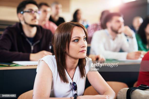 beautiful blue eyed student - participant stock pictures, royalty-free photos & images