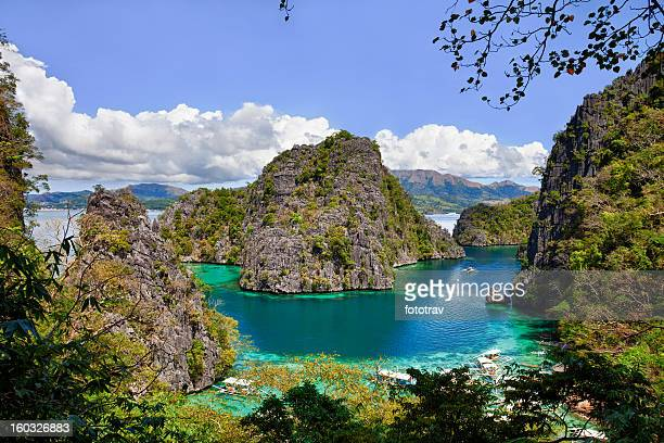 beautiful blue lagoon at kayangan lake in the philippines - palawan island stock pictures, royalty-free photos & images