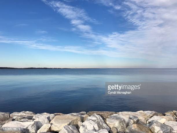 beautiful blue sky over the chesapeake bay, north point state park - maryland us state stock pictures, royalty-free photos & images