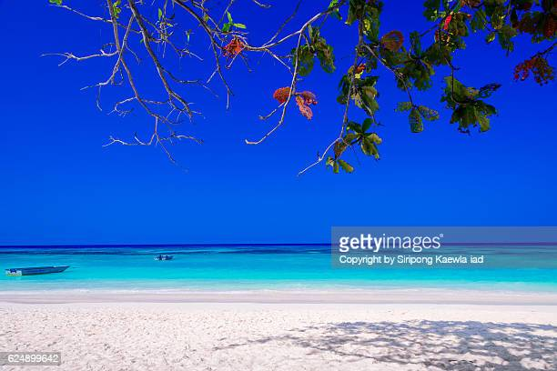 Beautiful blue sky, white sand and turquoise sea from Ta Chai island, Thailand.