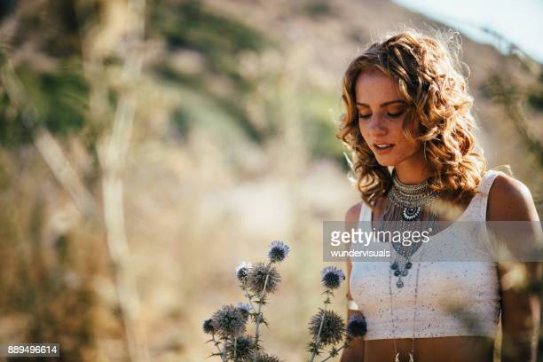 Beautiful bohemian girl relaxing in autumn golden field
