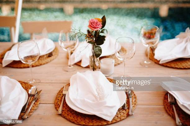 beautiful boho wedding table decoration with the swimming pool in the background in majorca - sport venue stock pictures, royalty-free photos & images
