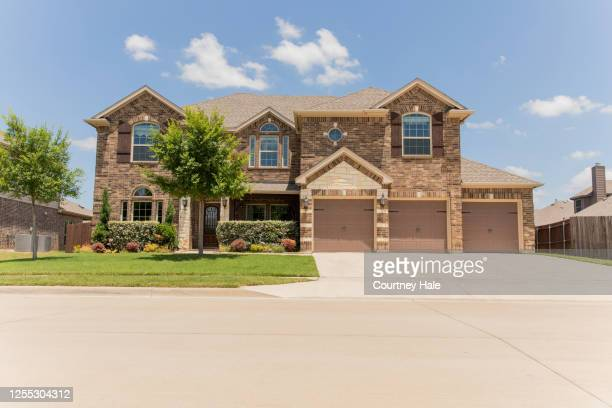 beautiful brick home on residential street in neighborhood - brick house stock pictures, royalty-free photos & images