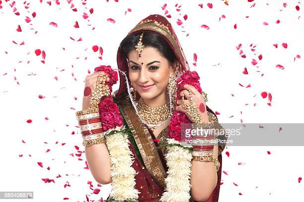 Beautiful bride holding a garland