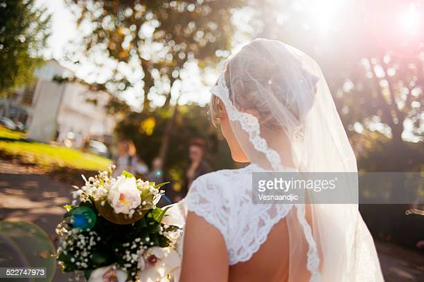 Beautiful bride holding flower bouquet