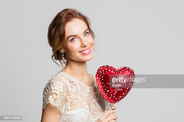 beautiful bride holding heart shape balloon - embellished dress stock pictures, royalty-free photos & images