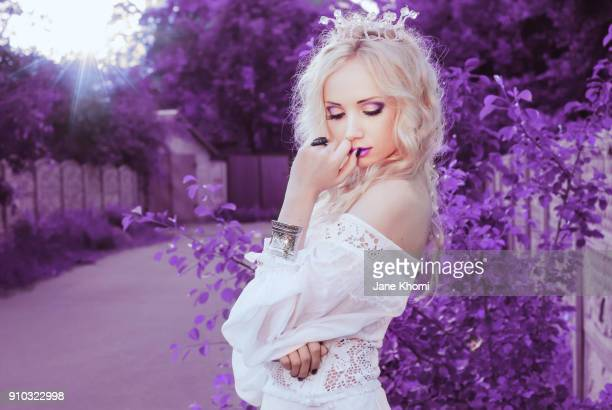 beautiful bride in violet garden - princess stock pictures, royalty-free photos & images