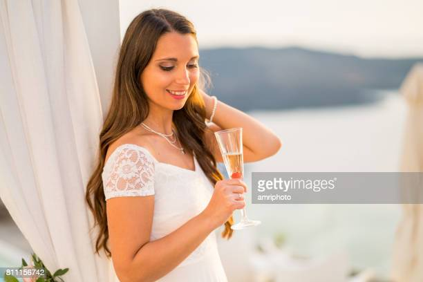beautiful bride in wedding dress with glass of champagne