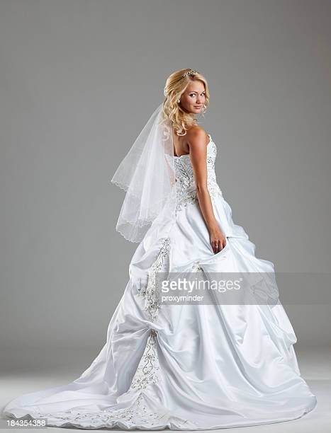 beautiful bride on gray background - veil stock pictures, royalty-free photos & images