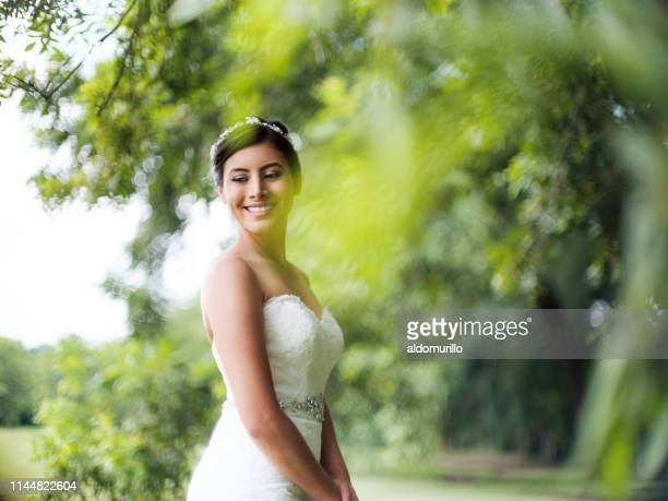 Beautiful bride standing outdoors and smiling