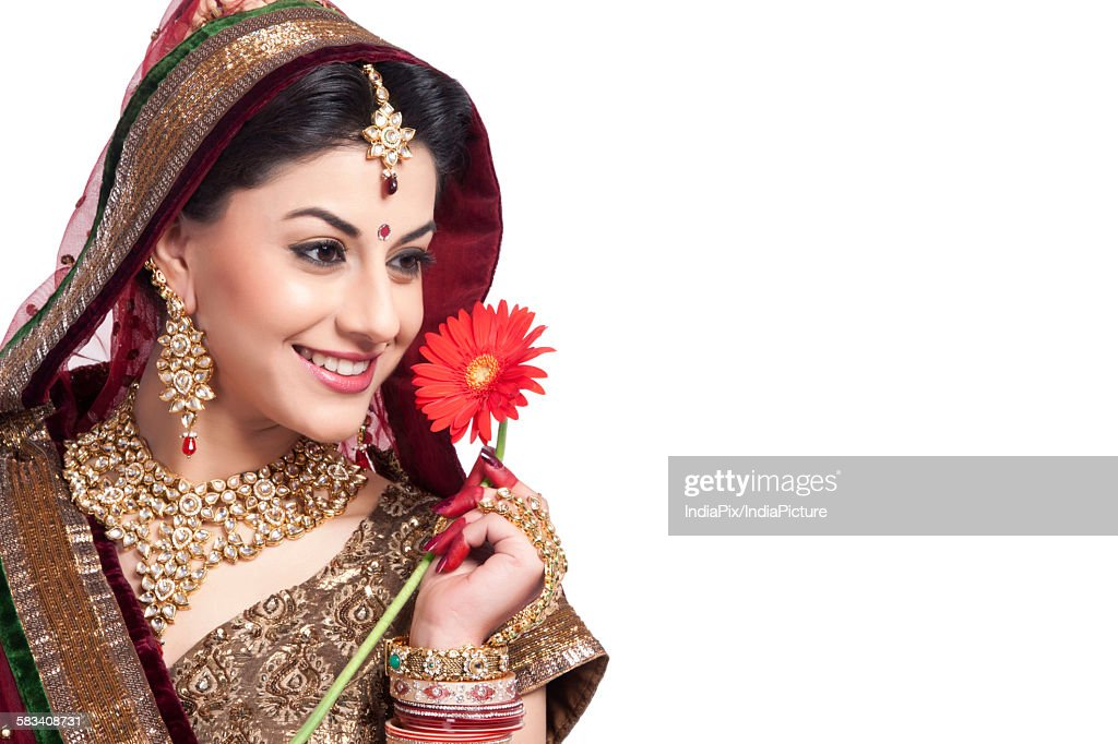 Beautiful bride with a flower : Stock Photo