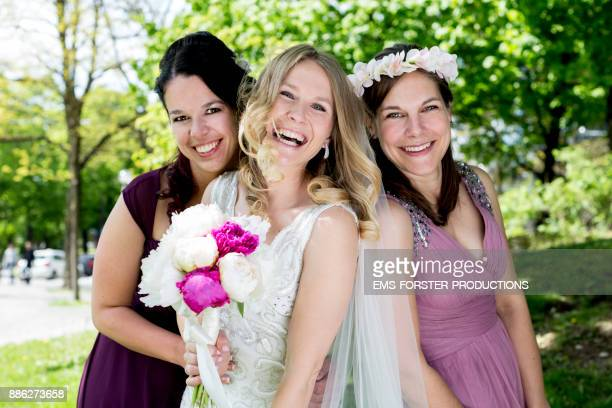 beautiful bride with her maids of honor at a shooting in a park