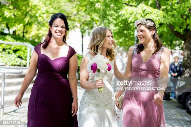 beautiful bride with her maids of honor on a sunny day