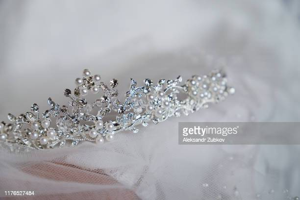 beautiful bride's crown is on the veil, close-up. wedding day. morning bride. - beauty contest stock pictures, royalty-free photos & images