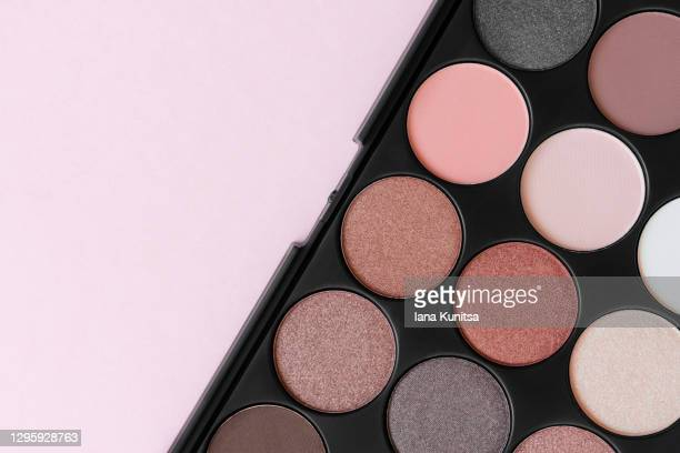beautiful brown eyeshadow palette. make-up. beauty banner. decorative cosmetics. tool for makeup artist. beige eye shadow. flat lay. closeup. pastel trendy colors. copy space. place for text. - アイシャドウ ストックフォトと画像