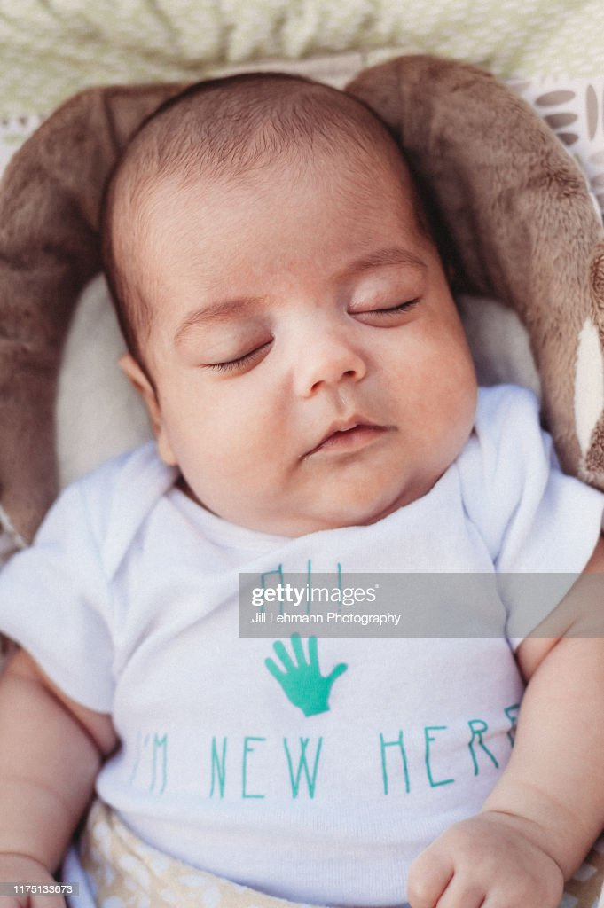 Beautiful Brown Haired And Chubby Newborn Baby Sleeps In A Padded Bed High Res Stock Photo Getty Images