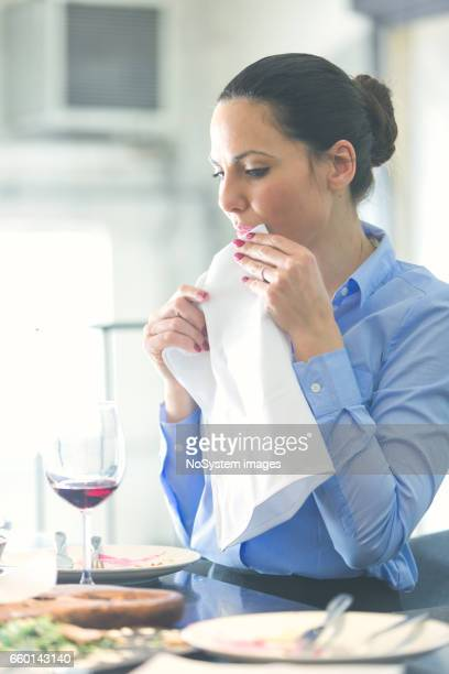 beautiful brunette businesswoman on lunch break - paper napkin stock photos and pictures