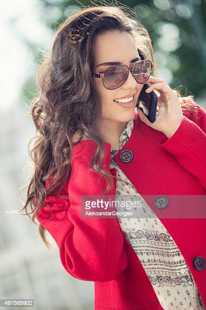 beautiful brunette businesswoman talking on the phone and smiling - aleksandar georgiev stock photos and pictures