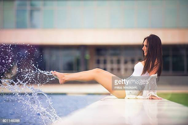 beautiful brunette by the fountain
