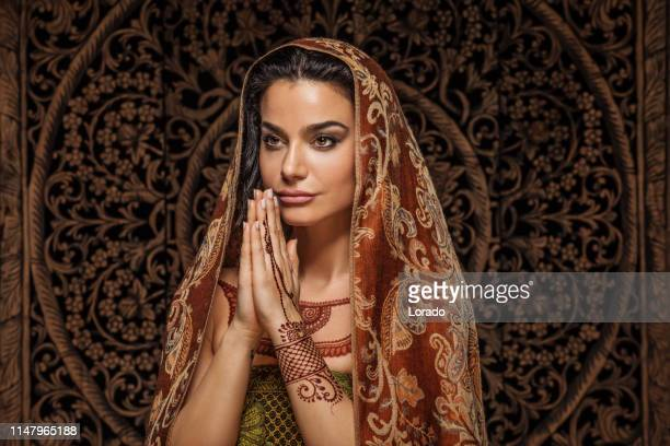 beautiful brunette ethnic woman wearing henna tattoo - iranian culture stock pictures, royalty-free photos & images