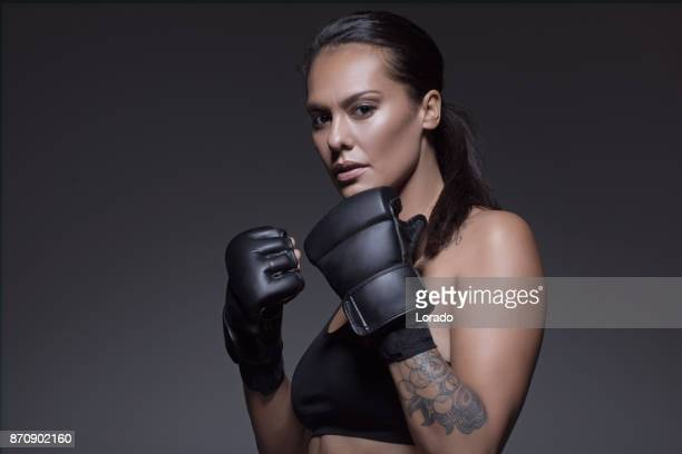beautiful brunette female fighter posing for potrait - mixed martial arts stock pictures, royalty-free photos & images