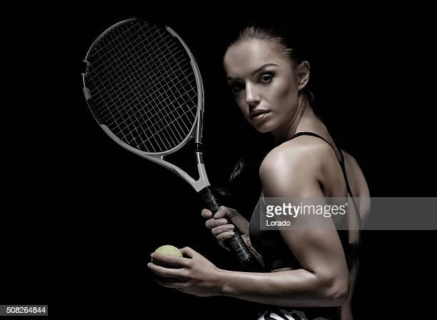 Beautiful brunette female tennis player