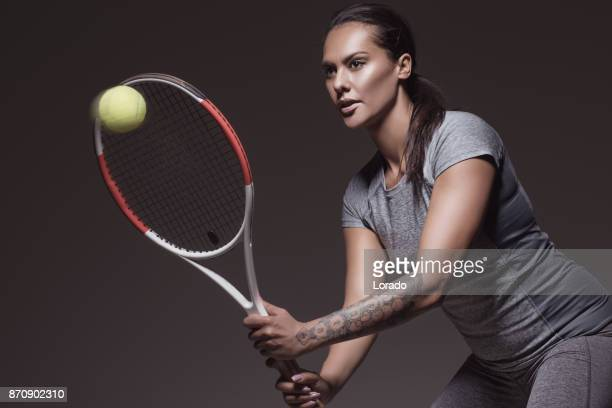 beautiful brunette female tennis player posing for portrait - tennis player stock pictures, royalty-free photos & images
