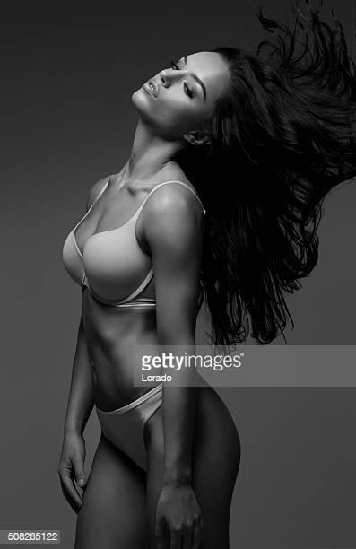 Beautiful brunette female wearing lingerie