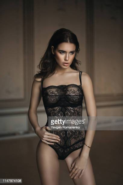 beautiful brunette girl posing in a black body lingerie - fashion show stock pictures, royalty-free photos & images