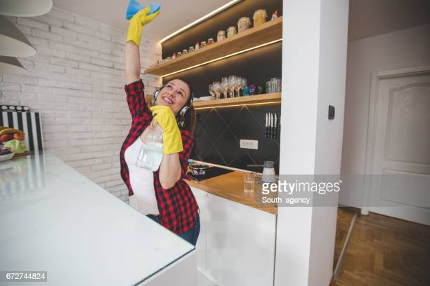 Beautiful brunette in kitchen cleaning