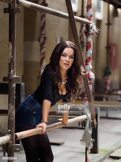 beautiful brunette on a construction site. - glasgow skottland bildbanksfoton och bilder