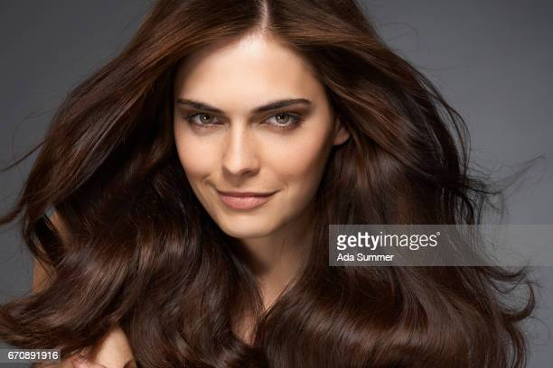 beautiful brunette - big hair stock photos and pictures