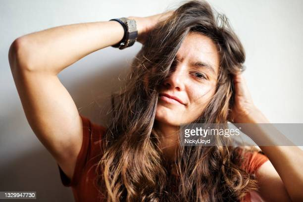 portrait beautiful woman with hands hair