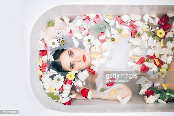 Beautiful brunette relaxing in bath