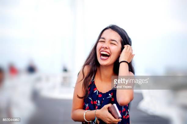 beautiful brunette teenanger laughing