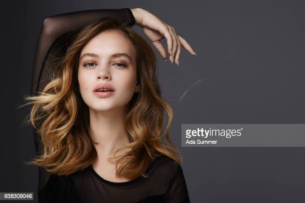 beautiful brunette with wavy hair - wavy hair stock pictures, royalty-free photos & images