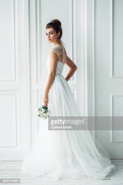 Beautiful brunette woman as bride with wedding bouquet