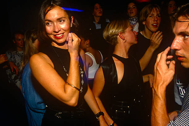 A beautiful brunette woman is watched by an unknown male in a club in London`s West End during a packed Bhangrathemed music night As if being stalked.