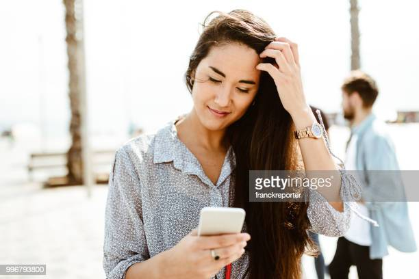 beautiful brunette woman portrait on the phone in the city